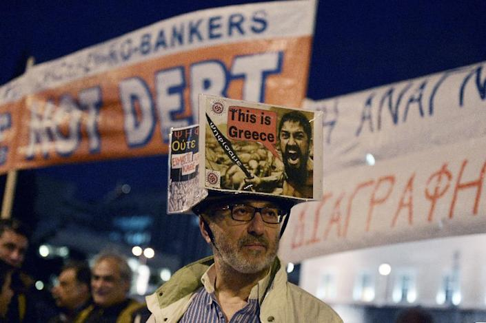 Eurozone ministers have handed Greece an ultimatum, saying it has this week to request an extension to its bailout (AFP Photo/Louisa Gouliamaki)