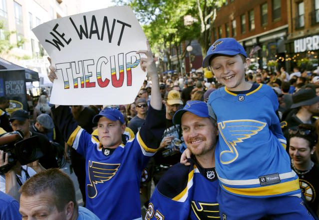 St. Louis Blues fans show support for their team outside TD Garden before Game 7 of the NHL hockey Stanley Cup Final between the Blues and the Boston Bruins, Wednesday, June 12, 2019, in Boston. (AP Photo/Michael Dwyer)