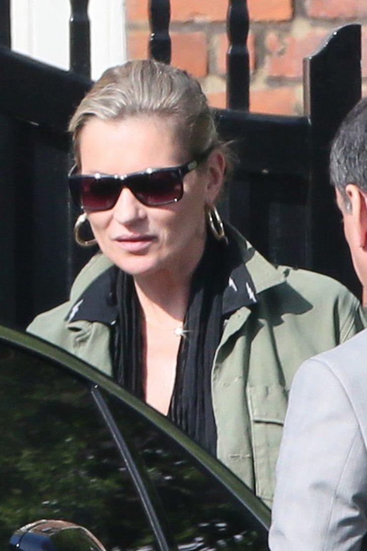 Kate Moss in matching gold hoops.