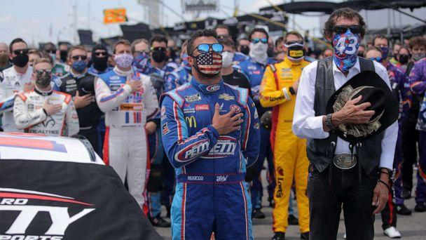 PHOTO: Bubba Wallace, driver of the #43 Victory Junction Chevrolet, and team owner, and NASCAR Hall of Famer Richard Petty stand for the national anthem prior to the NASCAR Cup Series GEICO 500 at Talladega Superspeedway on June 22, 2020. (Chris Graythen/Getty Images)