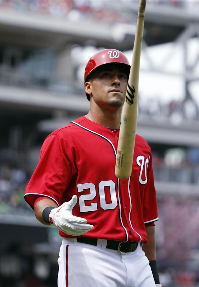 Washington Nationals shortstop Ian Desmond flips his bat after striking out during the fourth inning of a baseball game against the St. Louis Cardinals at Nationals Park on Saturday, April 19, 2014, in Washington. (AP Photo/Alex Brandon)