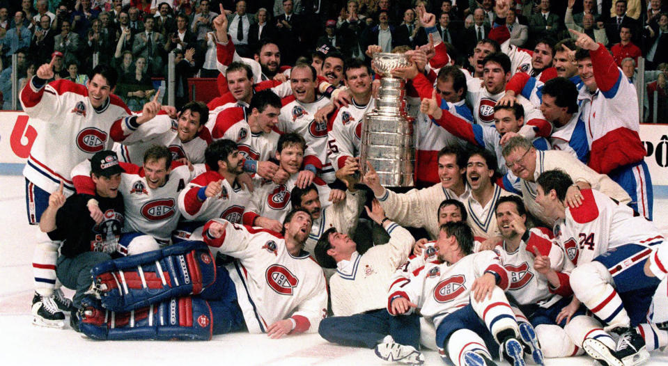 FILE - The Montreal Canadiens pose for a photograph with the Stanley Cup following their 4-1 victory over the Los Angeles Kings in Montreal, in this June 9, 1993, file photo. Patrick Roy is at front left lying down. The Montreal Canadiens bid to end Canada's Stanley Cup drought brings back memories of the building in which they last won the title in 1993. The Montreal Forum still stands, but it's significance is beginning to fade. (Frank Gunn/The Canadian Press via AP, File)