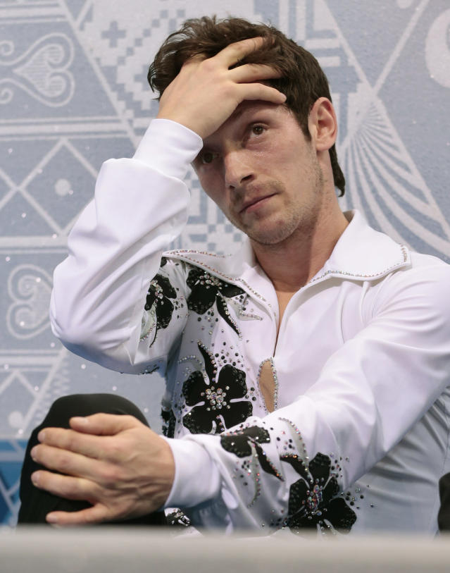 Zoltan Kelemen of Romania reacts after the men's short program figure skating competition at the Iceberg Skating Palace during the 2014 Winter Olympics, Thursday, Feb. 13, 2014, in Sochi, Russia. (AP Photo/Ivan Sekretarev)