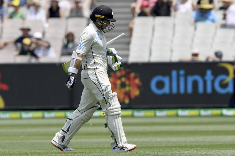 New Zealand's Tom Latham leaves the field after being dismissed by Australia during their cricket test match in Melbourne, Australia, Saturday, Dec. 28, 2019. (AP Photo/Andy Brownbill)