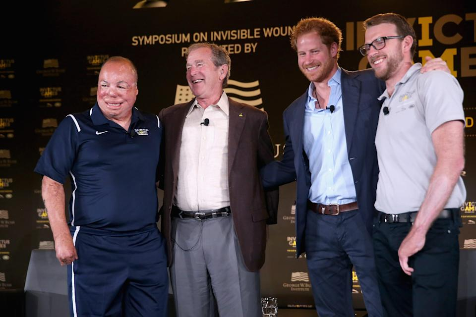 Prince Harry, second from right, and Royal Marine veteran J.J. Chalmers, right, attend Invictus Games Orlando in Orlando, Florida, on May 8, 2016, with Air Force Technical Sgt. Israel Del Toro, left, and former President George W. Bush, second from left.
