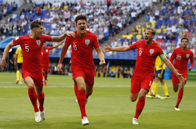 <p>England's Harry Maguire, centre, celebrates with his teammates after scoring </p>