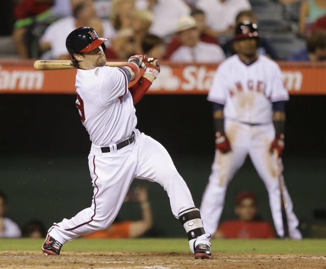 Los Angeles Angels' Collin Cowgill watches his three-run double against the Tampa Bay Rays during the second inning of a baseball game in Anaheim, Calif., Thursday, Sept. 5, 2013. (AP Photo/Chris Carlson)