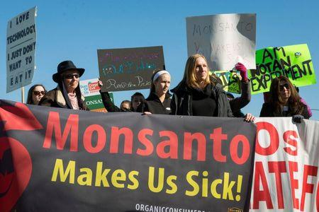 File photo of activists protesting against the production of herbicides and GMO food products outside Monsanto headquarters in Creve Coeur