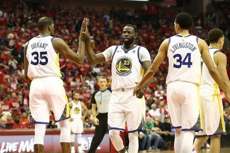 May 14, 2018; Houston, TX, USA; Golden State Warriors forward Kevin Durant (35) celebrates with forward Draymond Green (23) and guard Shaun Livingston (34) during the fourth quarter against the Houston Rockets in game one of the Western conference finals of the 2018 NBA Playoffs at Toyota Center. Mandatory Credit: Troy Taormina-USA TODAY Sports