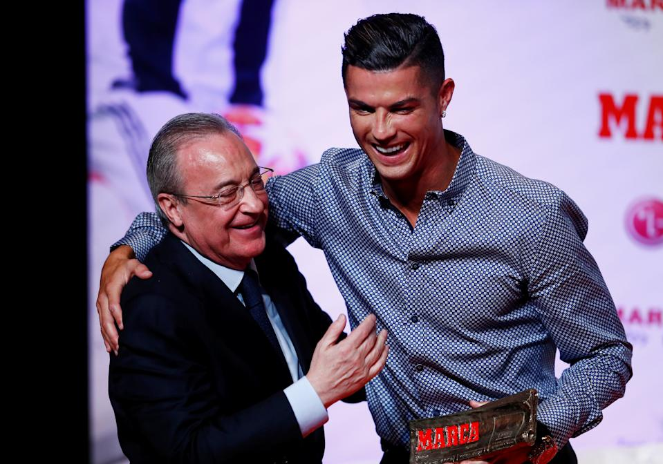 Soccer Football - Cristiano Ronaldo receives the MARCA Legend award - Reina Victoria Theater, Madrid, Spain - July 29, 2019   Cristiano Ronaldo poses with Real Madrid president Florentino Perez and the MARCA Legend award   REUTERS/Juan Medina