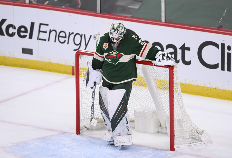 Minnesota Wild goaltender Cam Talbot looks down after allowing the go-ahead goal by Vegas Golden Knights right wing Reilly Smith during the second period in Game 3 of an NHL hockey Stanley Cup first-round playoff series Thursday, May 20, 2021, in St. Paul, Minn. (Aaron Lavinsky/Star Tribune via AP)