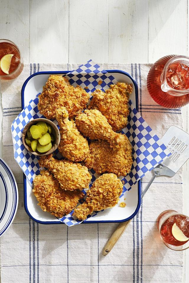 """<p>Savor all the joys of crispy chicken on a cool summer night with this recipe that puts a lighter spin on the fried dish.</p><p><strong><a href=""""https://www.countryliving.com/food-drinks/a30417464/cornflake-crusted-baked-chicken-recipe/"""">Get the recipe.</a></strong></p><p><strong><a class=""""body-btn-link"""" href=""""https://www.amazon.com/New-Star-Foodservice-36862-Commercial/dp/B009LA10OA/?tag=syn-yahoo-20&ascsubtag=%5Bartid%7C10050.g.4381%5Bsrc%7Cyahoo-us"""" target=""""_blank"""">SHOP BAKING SHEETS</a><br></strong></p>"""