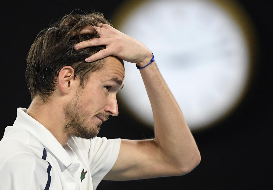 Russia's Daniil Medvedev reacts during his match against Serbia's Novak Djokovic in the men's singles final at the Australian Open tennis championship in Melbourne, Australia, Sunday, Feb. 21, 2021.(AP Photo/Andy Brownbill)