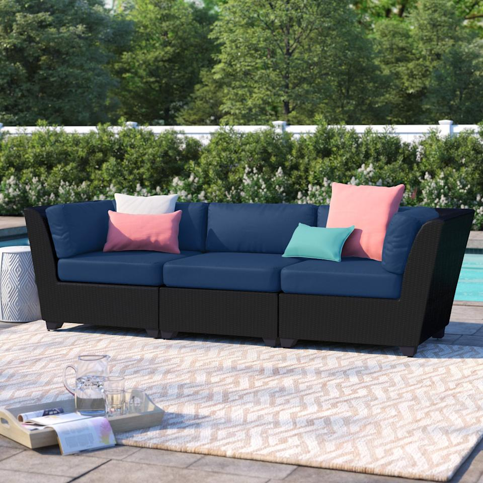 """<p>You can add some colorful pillows to this <a href=""""https://www.popsugar.com/buy/Sol-72-Outdoor-Tegan-Patio-Sofa-Cushions-582216?p_name=Sol%2072%20Outdoor%20Tegan%20Patio%20Sofa%20With%20Cushions&retailer=wayfair.com&pid=582216&price=970&evar1=casa%3Auk&evar9=47551929&evar98=https%3A%2F%2Fwww.popsugar.com%2Fhome%2Fphoto-gallery%2F47551929%2Fimage%2F47551996%2FSol-72-Outdoor-Tegan-Patio-Sofa-With-Cushions&list1=furniture%2Coutdoor%20decorating%2Chome%20shopping&prop13=api&pdata=1"""" rel=""""nofollow"""" data-shoppable-link=""""1"""" target=""""_blank"""" class=""""ga-track"""" data-ga-category=""""Related"""" data-ga-label=""""https://www.wayfair.com/outdoor/pdp/sol-72-outdoor-tegan-patio-sofa-with-cushions-w002019467.html"""" data-ga-action=""""In-Line Links"""">Sol 72 Outdoor Tegan Patio Sofa With Cushions</a> ($970, originally $1,600).</p>"""