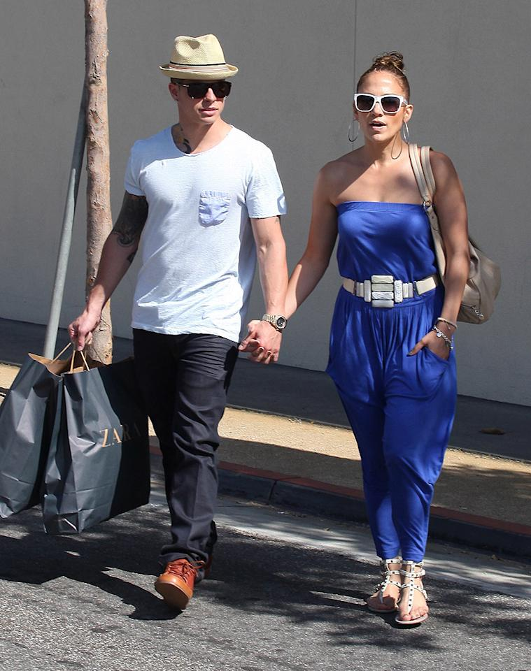 Jennifer Lopez and her 25-year-old main squeeze Casper Smart spent a sunny afternoon in L.A. shopping at The Grove, where the actress/singer loaded up on clothing from Zara. Though she landed at the top of Forbes' annual Celeb 100 list last week, J.Lo apparently still likes affordable fashion! (5/20/2012)