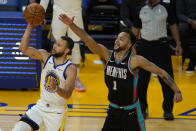 Golden State Warriors guard Stephen Curry, left, shoots against Memphis Grizzlies forward Kyle Anderson (1) during the second half of an NBA basketball game in San Francisco, Sunday, May 16, 2021. (AP Photo/Jeff Chiu)
