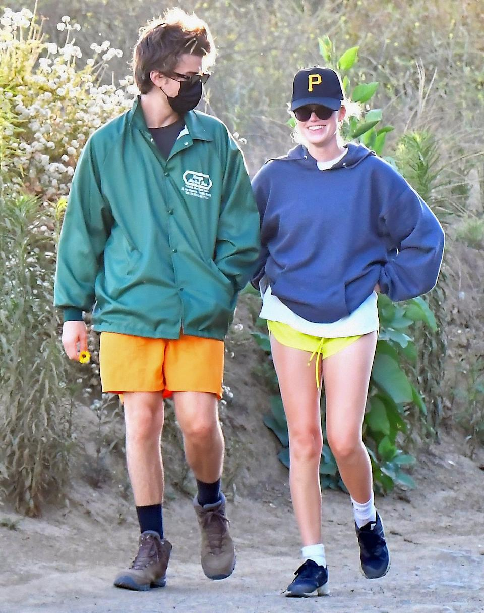 <p><em>Stranger Things</em> star Joe Keery and girlfriend Maika Monroe stick together on Friday during a hike in Los Angeles. </p>