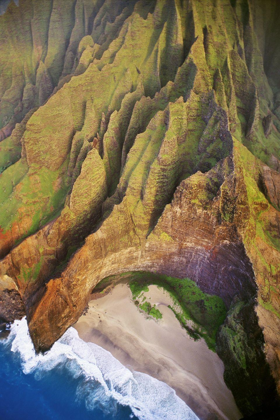 """<p><strong>Where: </strong><a href=""""https://go.redirectingat.com?id=74968X1596630&url=https%3A%2F%2Fwww.tripadvisor.com%2FTourism-g29218-Kauai_Hawaii-Vacations.html&sref=https%3A%2F%2Fwww.bestproducts.com%2Flifestyle%2Fg35651279%2Fmost-beautiful-places-in-america%2F"""" rel=""""nofollow noopener"""" target=""""_blank"""" data-ylk=""""slk:Honopu Beach, Hawaii"""" class=""""link rapid-noclick-resp"""">Honopu Beach, Hawaii</a></p><p><strong>Why We Love It: </strong>While there are too many <a href=""""https://www.countryliving.com/life/travel/g4033/best-beaches-in-usa/"""" rel=""""nofollow noopener"""" target=""""_blank"""" data-ylk=""""slk:beautiful beaches"""" class=""""link rapid-noclick-resp"""">beautiful beaches</a> in Hawaii to pick just one, the remoteness of this stretch of sand on Kauai's Na Pali Coast make it one of our favorites.</p>"""