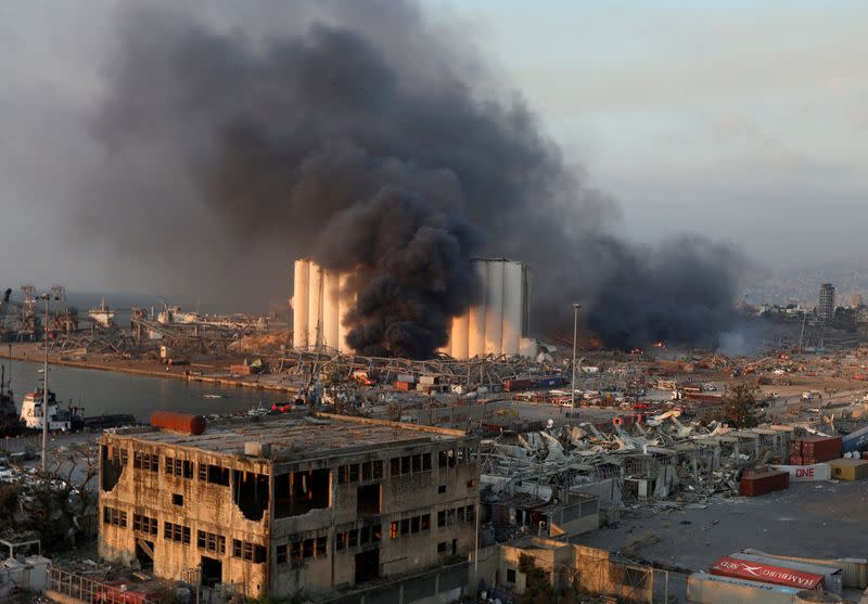 FILE PHOTO: Smoke rises from the site of an explosion in Beirut's port area