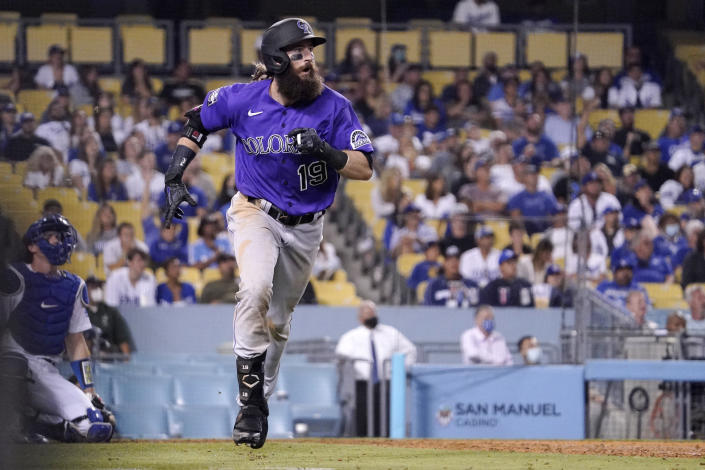 Colorado Rockies' Charlie Blackmon runs to first after hitting a two-run home run as Los Angeles Dodgers catcher Will Smith kneels at the plate during the 10th inning of a baseball game Friday, July 23, 2021, in Los Angeles. (AP Photo/Mark J. Terrill)