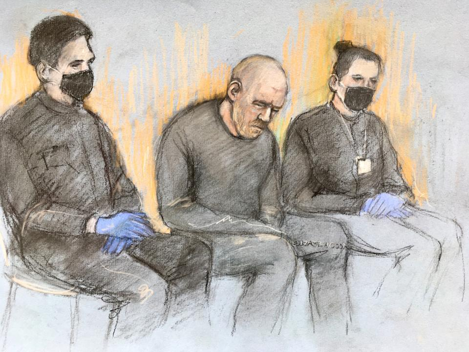 Court artist sketch by Elizabeth Cook of serving police constable Wayne Couzens (centre), appearing in the dock at Westminster Magistrates' Court, in London where he is charged with murder and kidnapping of Sarah Everard. Picture date: Saturday March 13, 2021.