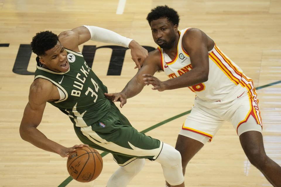Milwaukee Bucks' Giannis Antetokounmpo is fouled by Atlanta Hawks' Solomon Hill during the first half of Game 1 of the NBA Eastern Conference basketball finals game Wednesday, June 23, 2021, in Milwaukee. (AP Photo/Morry Gash)