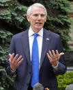 FILE—In this file photo from June 2, 2021, Senator Rob Portman, R-Ohio, speaks during a briefing at the Ukrainian Presidential office after a meeting with Ukrainian President Volodymyr Zelenskiy in Kyiv, Ukraine. Portman, a three-decade Washington veteran who plans to retire rather than run next year, stood with Democratic President Joe Biden, and for a moment this week, it was like the old days in Washington. as Biden announced a bipartisan infrastructure package. (AP Photo/Efrem Lukatsky, File)