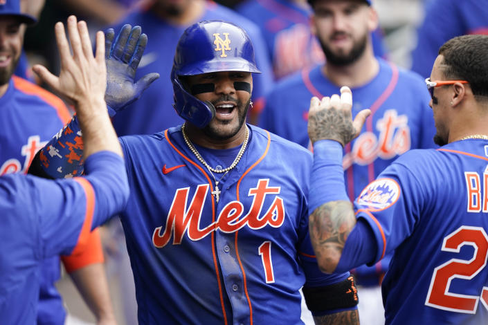 New York Mets' Jonathan Villar (1) celebrates in the dugout after his two-run home run scores Dominic Smith during the sixth inning of a baseball game against the Washington Nationals, Sunday, Aug. 29, 2021, in New York. (AP Photo/Corey Sipkin)