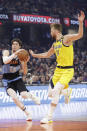 Cleveland Cavaliers' Cedi Osman (16) drives past Indiana Pacers' Domantas Sabonis (11) in the first half of an NBA basketball game, Saturday, Feb. 29, 2020, in Cleveland. (AP Photo/Tony Dejak)