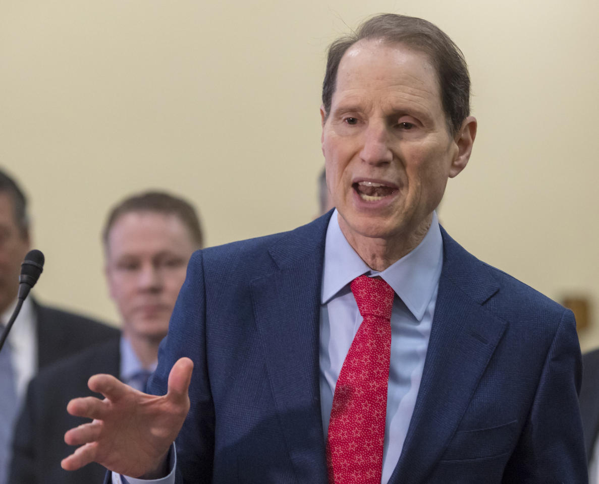 FILE - In this Jan. 10, 2018, file photo Sen. Ron Wyden, D-Ore., speaks at the Capitol in Washington. Some Medicare beneficiaries would face higher prescription drug costs under President Donald Trump's budget even as the sickest patients save money. That may make it harder to sell the complex plan to Congress in an election year. (AP Photo/J. Scott Applewhite, File)