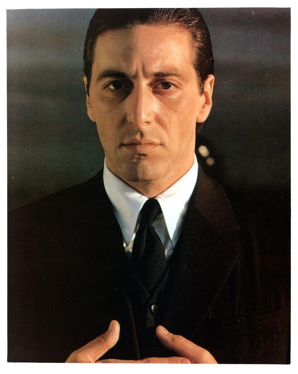 <p>Pacino poses as Michael Corleone during a film photoshoot. The young actor rose to fame playing the Mafia son, but he wasn't Paramount's first choice for the role. The studio originally looked at more established actors, like Robert Redford and Dustin Hoffman. </p>