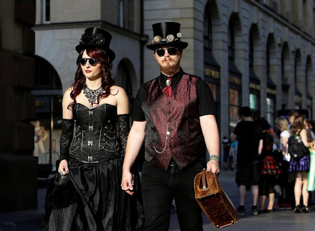 <p>Participants of the Wave and Goth festival walk through a street in Leipzig city center, Germany, June 2, 2017. (David W Cerny/Reuters) </p>