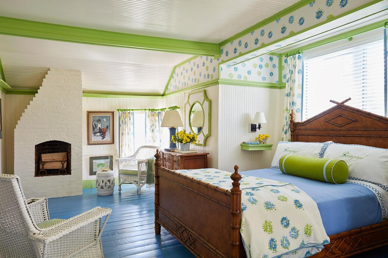 <p>What was originally a master bedroom was transformed-with the help of architect Michael Elfenbein-into a cheerful guest suite. Reynal collaborated with Alexandra Reboul of Aliprints Design studio to come up with a Wheeler-inspired print that would unify the room's eclectic layout. </p>