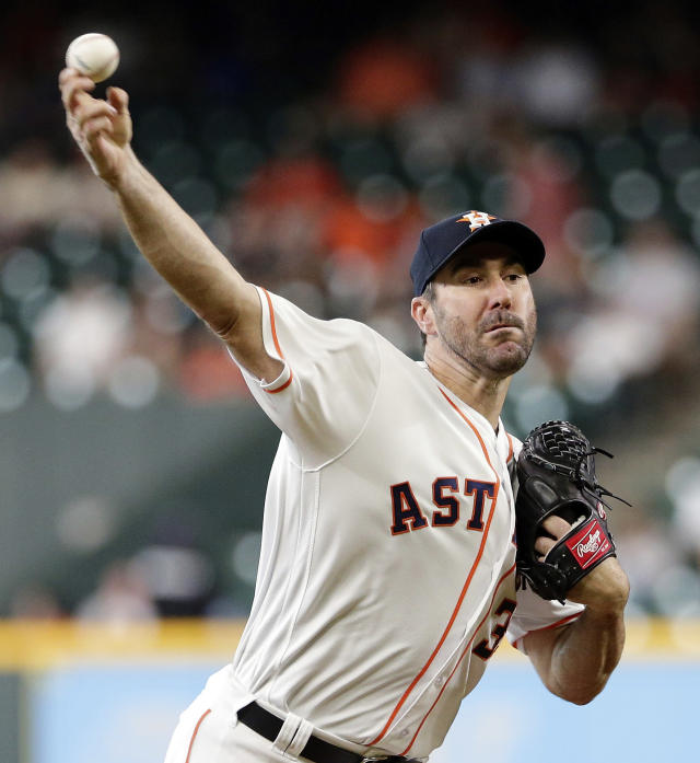 Houston Astros starting pitcher Justin Verlander (35) throws against the San Francisco Giants during the first inning of a baseball game Wednesday, May 23, 2018, in Houston. (AP Photo/Michael Wyke)