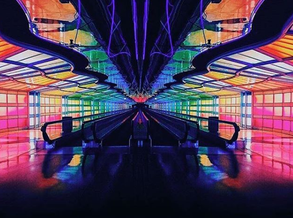 <p>It feels more like a nightclub than an airport, but the neon-lit walkway at Chicago's O'Hare Airport is guaranteed to brighten your day. Photo: Instagram/dannymota </p>