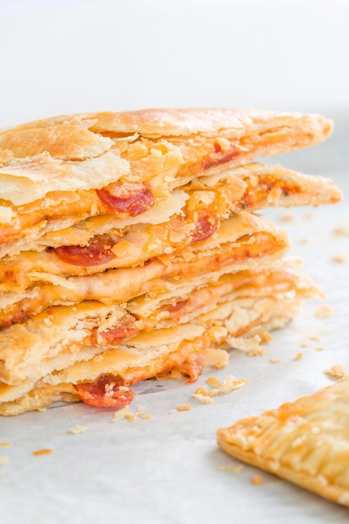 """<p><span>Way healthier than anything you'll find in the freezer aisle.</span></p><p><span>Get the recipe from </span><a href=""""https://www.delish.com/cooking/recipe-ideas/recipes/a44093/pizza-homemade-hot-pockets-recipe/"""" rel=""""nofollow noopener"""" target=""""_blank"""" data-ylk=""""slk:Delish"""" class=""""link rapid-noclick-resp"""">Delish</a><span>.</span><br></p>"""