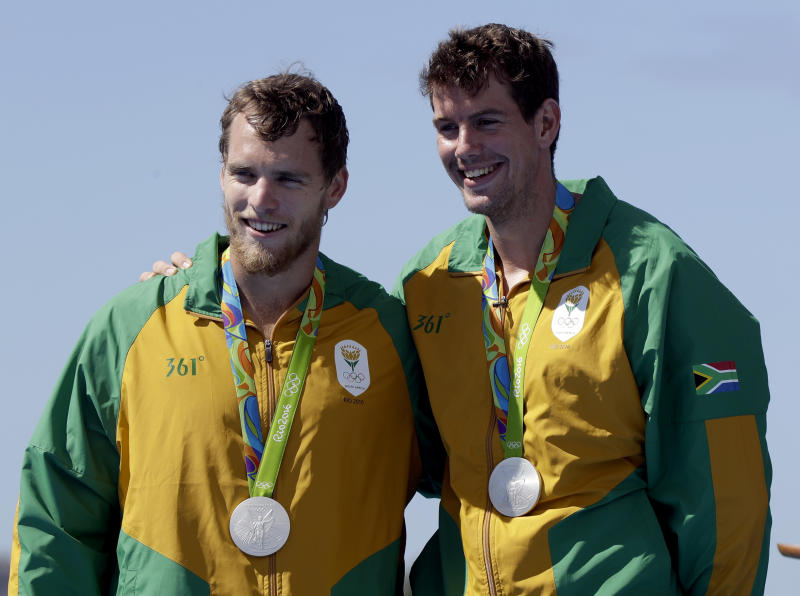 Lawrence Brittain and Shaun Keeling, of South Africa, smile after winning silver in the men's pair final during the 2016 Summer Olympics in Rio de Janeiro, Brazil, Thursday, Aug. 11, 2016. (AP Photo/Luca Bruno)