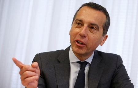 Austria's Chancellor Kern addresses a news conference in Vienna
