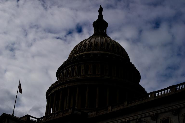The US Capitol is silhouetted on September 28, 2013 in Washington