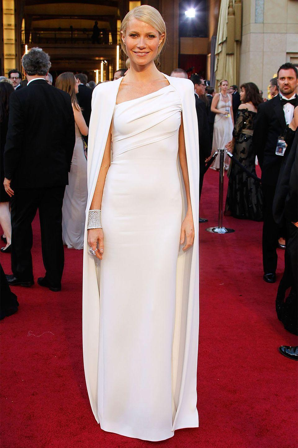 <p>Gwyneth Paltrow pioneered the caped trend at the 2012 Academy Awards in this Tom Ford, which became one of the biggest fashion trends from outerwear to cocktail dresses. </p>
