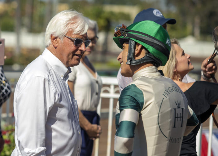 In this image provided by Benoit Photo, trainer Bob Baffert, left, celebrates with jockey John Velazquez, right, after Gamine's victory in the Grade II, $200,000 Great Lady M Stakes horse race Monday, July 5, 2021, at Los Alamitos Race Course in Cypress, Calif. (Benoit Photo via AP)