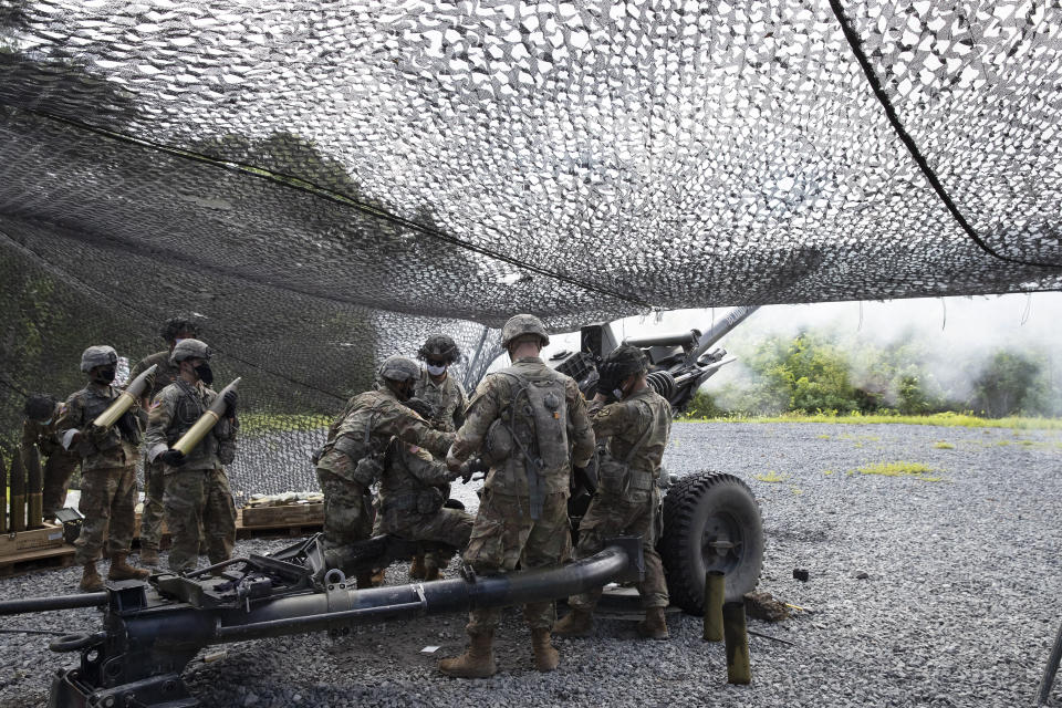 Cadets learn to fire a 105mm howitzer, Friday, Aug. 7, 2020, at the U.S. Military Academy in West Point, N.Y. The pandemic is not stopping summer training. Cadets had to wear masks this year for much of the training. (AP Photo/Mark Lennihan)
