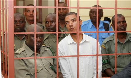 Jermaine John Grant, a British citizen, is guarded by Kenyan police in court in Shanzu