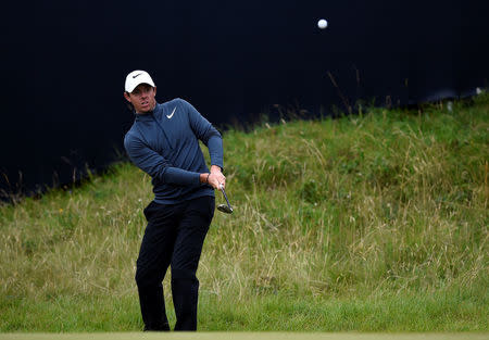 Golf - The 146th Open Championship - Royal Birkdale - Southport, Britain - July 21, 2017   Northern Ireland's Rory McIlroy chips onto the 14th green during the second round    REUTERS/Hannah McKay