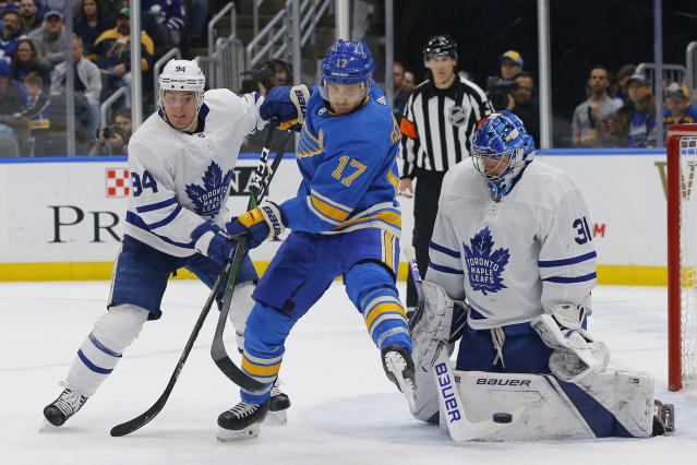 Toronto Maple Leafs' Tyson Barrie (94) and goaltender Frederik Andersen, of Denmark, (31) defend a shot as St. Louis Blues' Jaden Schwartz (17) attempts a screen during the second period of an NHL hockey game Saturday, Dec. 7, 2019, in St. Louis. (AP Photo/Billy Hurst)