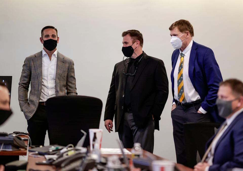 Head coach Matt LaFleur, from left, general manager Brian Gutekunst and team president Mark Murphy gather in the Green Bay Packers draft room at Lambeau Field on Thursday, April 29, 2021.