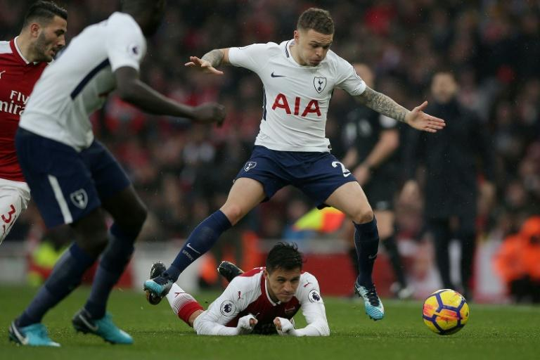 Tottenham Hotspur's Kieran Trippier jumps over Arsenal's Alexis Sanchez during their English Premier League match, at the Emirates Stadium in London, on November 18, 2017