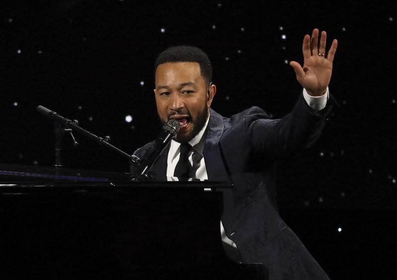 FILE - This March 5, 2020 file photo shows John Legend performing at The Alliance for Children's Rights 28th Annual Dinner in Beverly Hills, Calif. The spreading coronavirus might have canceled several touring performances from A-list musical artists, but those acts have found a new venue to sing: their living rooms. Legend, Bono, Coldplay's Chris Martin, Pink, John Mayer, Keith Urban and more have held virtual concerts from their homes as the world continues to practice social distancing to slow the spread of the virus. (Photo by Willy Sanjuan/Invision/AP, File)