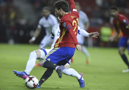 Football Soccer - Spain v Israel - 2018 World Cup Qualifying European Zone - Group G - El Molinon Stadium, Gijon, Spain, 24/3/17 Spain's David Silva shots to score first goal. REUTERS/Eloy Alonso