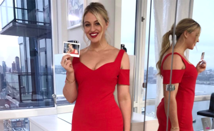 Iskra in a fitting red dress